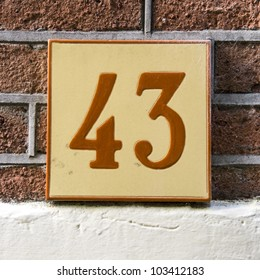 ceramic tile with the house number forty-three