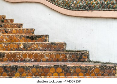 Ceramic tile staircase with part of dragon stucco railing