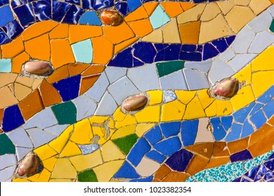 Ceramic tile vintage pattern. Broken glass mosaic tile, decoration in Park Guell, Barcelona, Spain. Designed by Gaudi