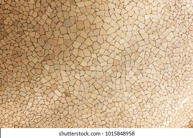 Ceramic tiles background, broken glass mosaic, decoration in Park Guell, Barcelona, Spain. Designed by Gaudi
