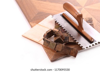 Ceramic tiles and made of solid wood and spatula on a white background