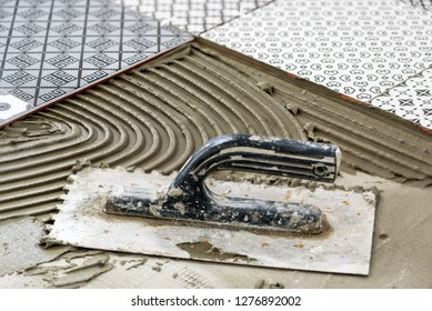 Ceramic tiles and tools for tiler. Floor tiles installation.