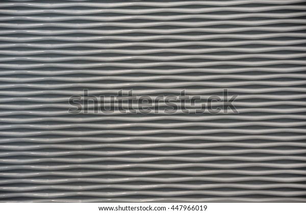 Ceramic tiles with a wavy relief structure, pattern, background, texture,