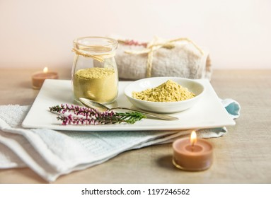 Ceramic tray with jar and bowl with mustard powder, towel and aroma candles to make foot bath. Against cold illness, congestion, aches and improves blood circulation.