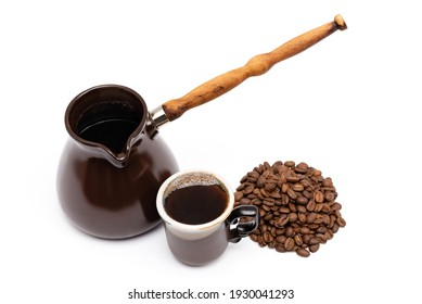 ceramic turk for coffee, cup of coffee and coffee beans on a white background