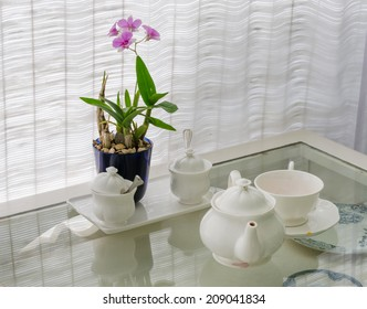 Ceramic utensils on table restaurant with flower decoration