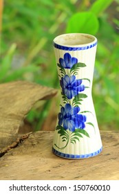 Ceramic vase with flower decoration on the table