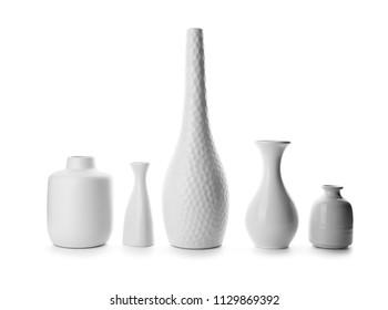 Ceramic vases on white background
