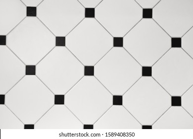 Ceramic white octagon with tessellation black tiles background