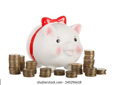 Ceramic white pig moneybox and gold coins