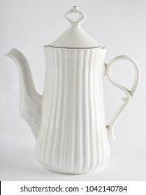 Ceramic white teapot on white background.