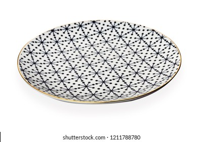 Ceramics decorative plates, Plate with geometric pattern and gold rim, isolated on white background with clipping path, Side view