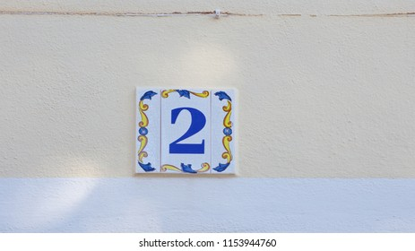 ceramics house number on the wall two