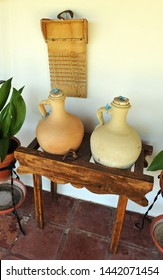 Ceramoc pitchers to contain drinking water and old washboard by hand that was formerly used in homes. Village house in Spain