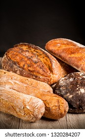 cereal baguette buckwheat bread with onions on dark background
