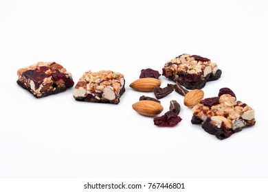 Cereal bar with almonds and cranberries chocolate on white background