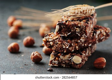 Cereal bar with nuts and chocolate, selective focus