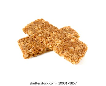 Cereal bars or flapjacks made from rolled oats isolated on white background