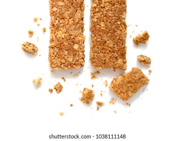 Cereal bars or flapjacks made from rolled oats with crumbs isolated on white background. Top view.