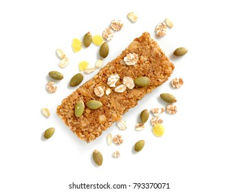 Cereal bars or flapjacks made from rolled oats with pumpkin seeds isolated on white background. Top view.