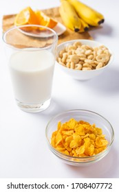 cereal bowls with a glass of milk and fruit