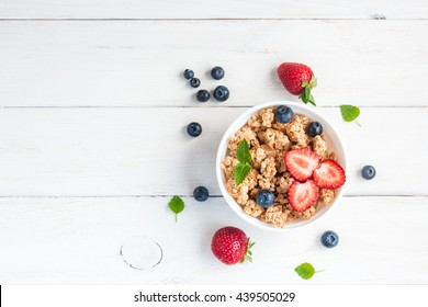Cereal. Breakfast with muesli and berries. Top view, flat lay.