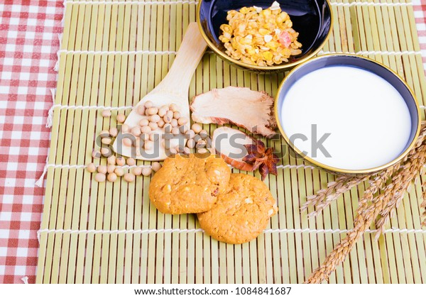 cereal cookies milk in bowl Cornflakes spices on wooden bamboo and copy space for text. top view