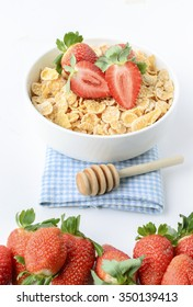 Cereal Cornflakes with strawberry on wood