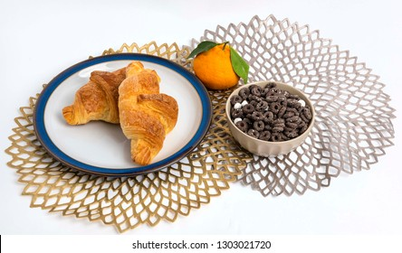 cereal with croissant and hallabong on the table cloth