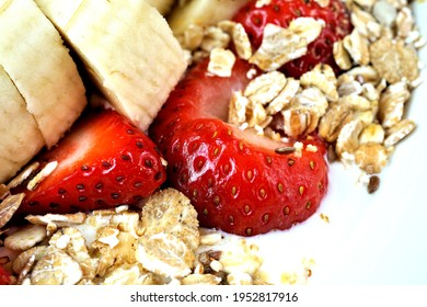 cereal with fresh fruits, strawberries and bananas