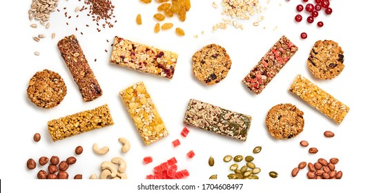 Cereal granola bar with nuts and dry fruit berries. Energy healthy snack. Protein muesli bars isolated on white background. Sport oatmeal bar, top view