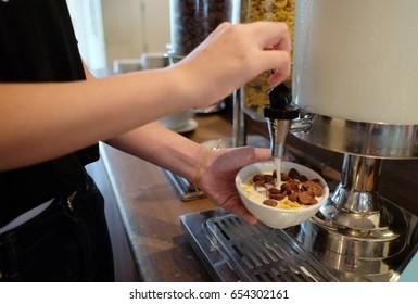 Cereal with milk in breakfast buffet