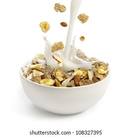 cereal and milk pouring into a white bowl