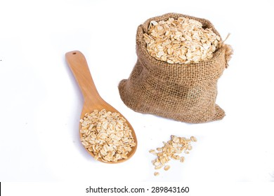 cereal in sack with wooden spoon on white background