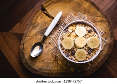 Cereal, seeds and oats, and banana slices, a healthy meal for breakfast or afternoon snack.