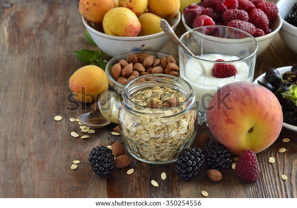 Cereals, almonds and various berries for breakfast, healthy nutrition