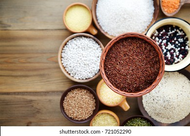 Cereals and legumes in bowls on wooden background.  Top view. Selective focus.