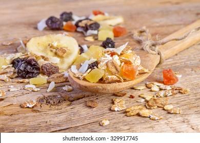 Cereals muesli food in wooden spoon on wooden background.