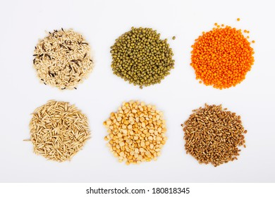 Cereals - wheat, rice, maize, mung beans, lentils and oats isolated on white background.