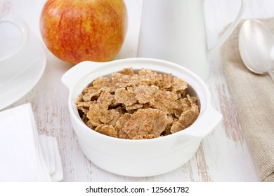 cereals in the white bowl with apple