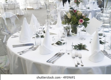 a ceremonial decorated dinner table in white