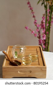 Ceremonial glass tea set on wooden board