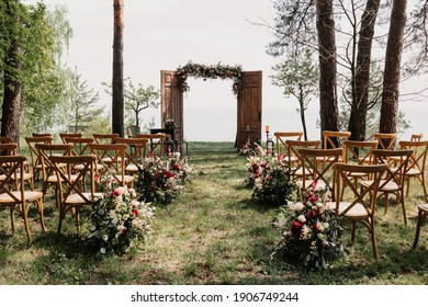 Ceremony, arch, wedding arch, wedding, wedding moment, decorations, decor, wedding decorations, flowers, chairs, outdoor ceremony in the open air, bouquets of flowers.  - Shutterstock ID 1906749244