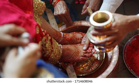 A ceremony of washing feet to the bride before her marriage by her female relatives, Nepali and Hindu ritual, tradition, culture, religious, Brahmin cast system, wedding day in Nepal, India