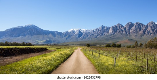 Ceres Mountains, Western Cape, South Africa - August 11th, 2018. Panoramic view of the snow covered mountains with vineyards during winter in the upper Breede River Valley region of South Africa.