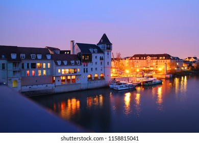 """Cergy-Pontoise, France: Yacht club """"Port Cergy"""" by the river of Oise in the old town. Quiet evening. Street lights. Illumination."""