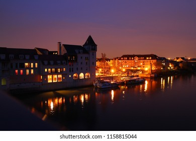 """Cergy-Pontoise, France: Yacht club """"Port Cergy"""" by the river of Oise in the old town. Night. Street lights. Illumination."""