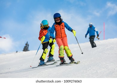 CERMIS, ITALY - 19 Jan 2018. The group of Little kids trains on a slope in Dolomites. Children on racing skis descend to a racing slopes. Concept sports and races. Italy