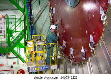 CERN, France - 25 June, 2019: A workers repairs part of The Large Hadron Collider (LHC) is seen underground inthe French part of CERN.