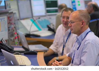 CERN, GENEVA - 20 NOV 2011 - Physicist at the control desk of the ATLAS experiment, at the days of re-opening of LHC, the Large Hadron Collider international high-energy physics experiment.